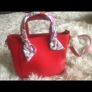 Cute brand new red cross body bag